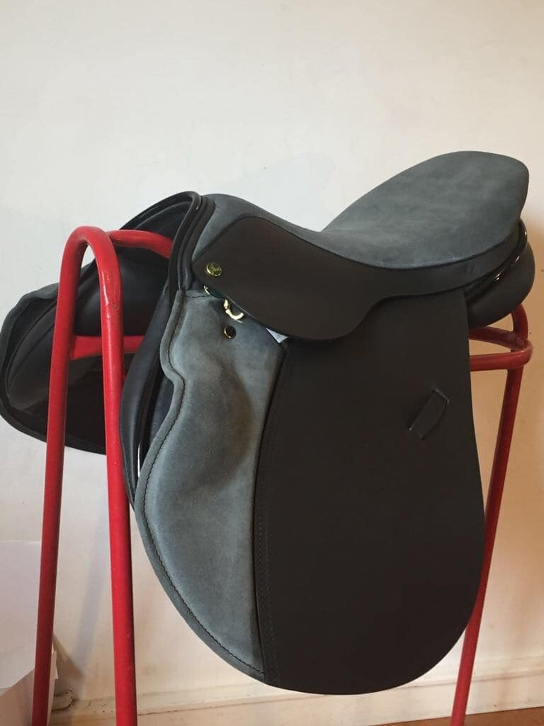 Ideal Impala 1450 Jump saddle in black Kilger leather and Persian suede with patent roll and piping.